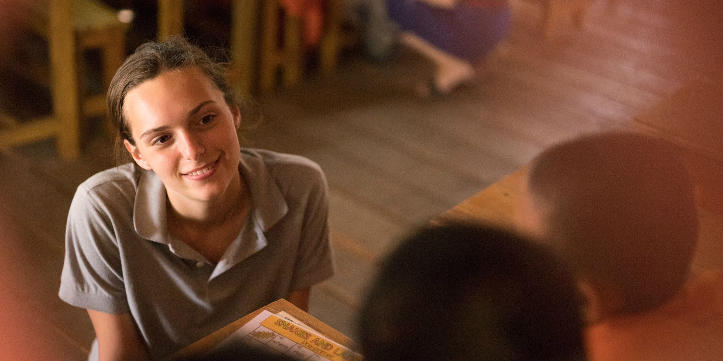 A TEFL teacher engages with students during a daily lesson with novice Buddhist monks.