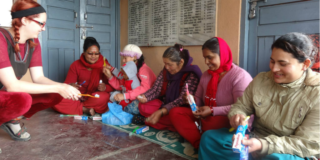 Volunteers teaching women about hygiene practises in India